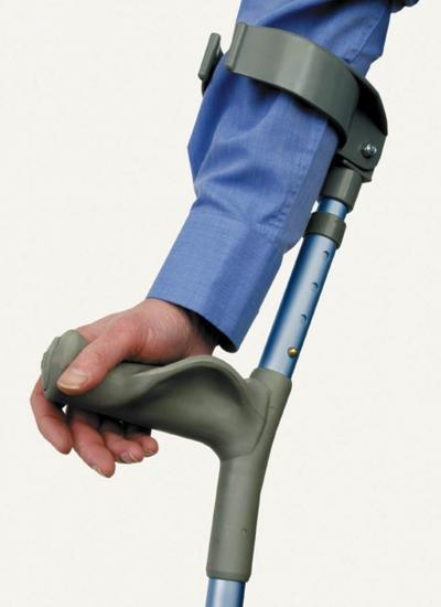 Close-up view of right forearm and hand hold a crutch with hand on moulded handle and crutch guide around forearm